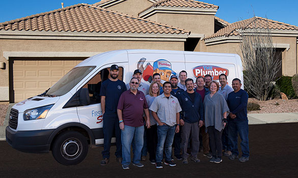 The Plumber Guy team standing in front of one of our vans